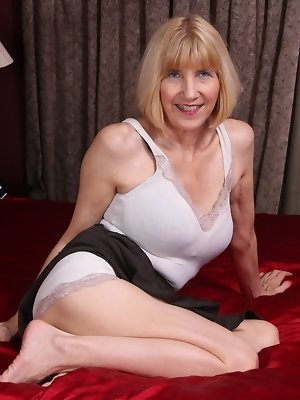 Naughty American mature lady playing alone