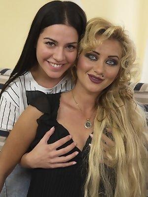 Cute hot babe having fun with a lesbian housewife