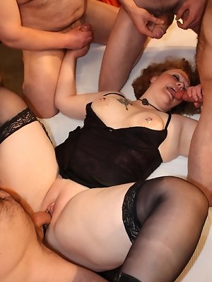 One naughty BBW housewife sucking and fucking in a ganbang